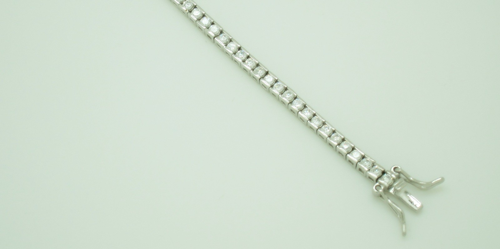 Pulsera pave riviere bisel lateral plata